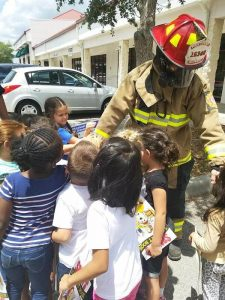 Children with firefighter outside of Montessori School of Davenport.